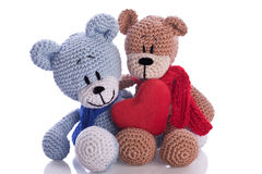 Two teddy bears with red heart pillow Stock Images