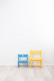 Two vintage child chairs Stock Photos