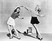 Two women dancing outside Stock Photography