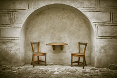 Two wooden chairs and table Stock Photography