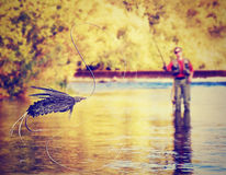 Uma pesca com mosca da pessoa Fotos de Stock Royalty Free