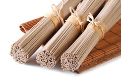 Unch raw buckwheat soba noodles close up isolated Royalty Free Stock Photos