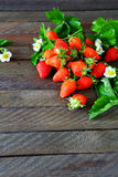 Unch of ripe strawberries on dark boards Royalty Free Stock Images