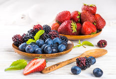 Вunch of wild berries and mint Stock Photos