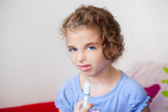Unhappy kid girl with syringe medicine dose Stock Image