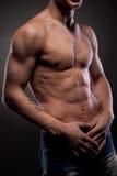 Uomo nudo muscolare Fotografie Stock Libere da Diritti