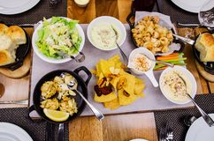 A variety of gourmet dishes at fancy restaurant Royalty Free Stock Photography
