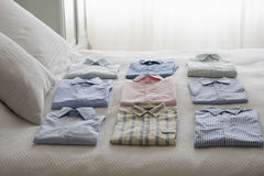 Variety Of Shirts On Bed Royalty Free Stock Photography