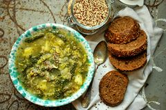 Vegan meal: quinoa soup with organic cabbage and potatoes Stock Images