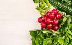 Vegetables ingredients for salad: radish, cucumber,lettuce on white wooden background, top view Stock Image