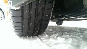 Vehicle driving on winter snow Stock Photos