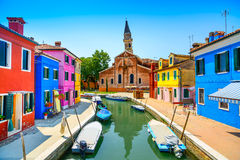 Venice landmark, Burano island canal, colorful houses, church and boats, Italy Stock Photography
