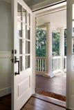 Vertical shot of an open, wooden front door Stock Image