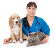 Veterinarian hugging cat and dog. isolated on white background Royalty Free Stock Photography