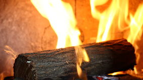 Video of a log in fireplace stock footage