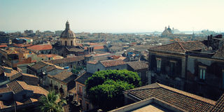 View of Catania city from the rooftop - retro filter. Old buildings. Royalty Free Stock Images