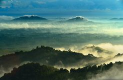 A view from mountains to the valley covered with smog in Thailand. Stock Images