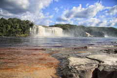 View to a powerful waterfall on a sunny bright day Stock Photography