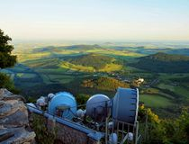 View from tower of meteorological observatory with many parabolic satellites to morning countryside. Spring morning Royalty Free Stock Photos
