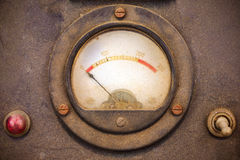 Vintage dusty volt meter in a metal casing Stock Image