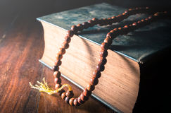Vintage filtered of Necklace on book,religion background. Royalty Free Stock Images