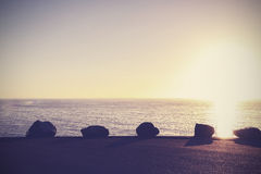 Vintage peaceful nature background, sunset over ocean. Royalty Free Stock Photo