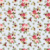 Vintage seamless pattern with pink roses on blue. Vector illustration. Stock Photos