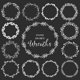 Vintage set of hand drawn rustic wreaths. Floral vector graphic Stock Image