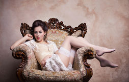 Vintage sexy young woman in corset Royalty Free Stock Image