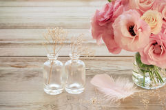 Vintage Still life with  Eustoma flowers in a vase with fearher Royalty Free Stock Image