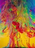Vivid Swirls of Liquid Paints Stock Images