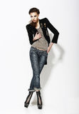 Vogue. Full Length Portrait of Stylish Woman in Informal Pose Royalty Free Stock Image