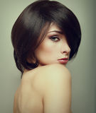 Vogue portrait of alluring woman with short hair Stock Image
