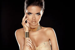 Vogue Style. Glamour Lady. Fashion Beauty Girl with Golden Jewel Stock Photo