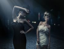 Vogue style photo of a two fashion ladies Royalty Free Stock Photography