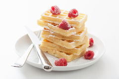 Waffles with raspberry and icing sugar Stock Photos