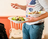 Waiter serving asian beef salad Stock Photography