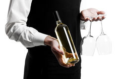 Waiter sommelier with wine bottle Royalty Free Stock Images