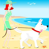 Walking the dog on the beach Stock Photography