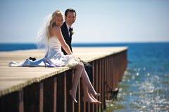 Wedding Couple on Dock Stock Images