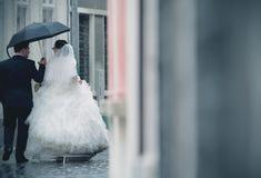 Wedding couple in rain Stock Photography