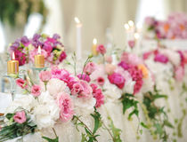 Wedding decoration on table. Floral arrangements and decoration. Arrangement of pink and white flowers in restaurant for event Royalty Free Stock Photography
