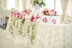 Wedding decoration on table. Floral arrangements and decoration. Arrangement of pink and white flowers in restaurant for event Stock Photos