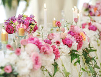 Wedding decoration on table. Floral arrangements and decoration. Arrangement of pink and white flowers in restaurant for event Royalty Free Stock Images