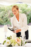 Wedding Planner Checking Table Decorations In Marquee Royalty Free Stock Photography