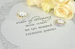 Wedding rings on contemporary invitation Royalty Free Stock Photos