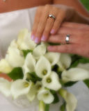 Wedding rings with flowers Royalty Free Stock Photos