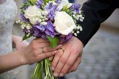 Wedding rings flowers Royalty Free Stock Photos