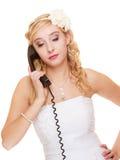 Wedding. Sad woman unhappy bride talking on phone Stock Images