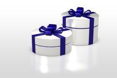 Weiße runde Geschenkbox mit blauem Band Stockbild